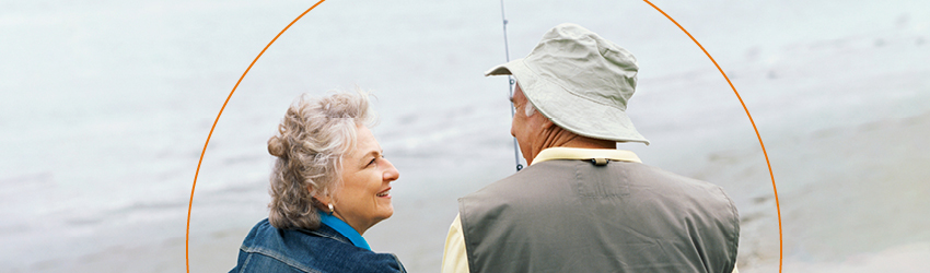 Senior couple fishing on beach
